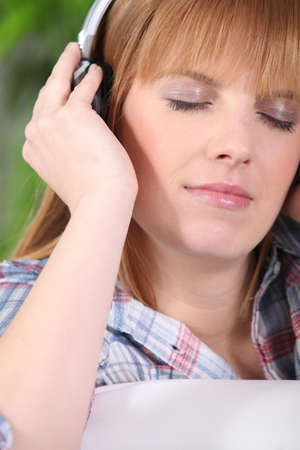 appease: Woman relaxing listening to music