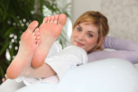 crossed fingers: Close up of female feet Stock Photo