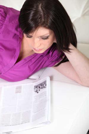 habitual: Brunette woman reading in bed