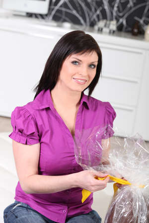 unwrapping: Woman unwrapping Easter egg