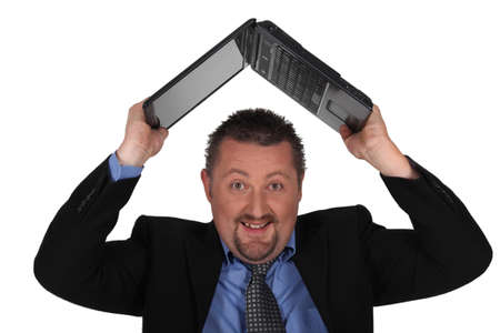 round face: Man lifting computer over his head