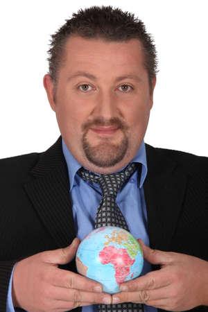online internet presence: Businessman holding a globe