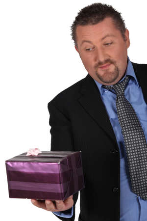 Businessman with a wrapped gift photo