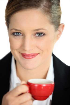 Businesswoman holding coffee mug photo