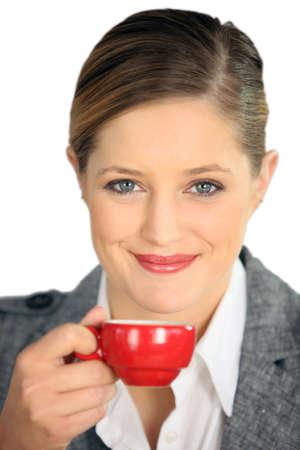 bracing: Brunette holding cup of espresso