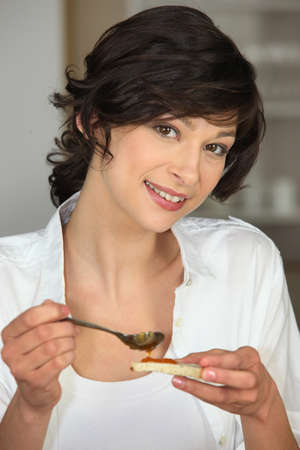 smeared hand: Brunette with slice of bread Stock Photo