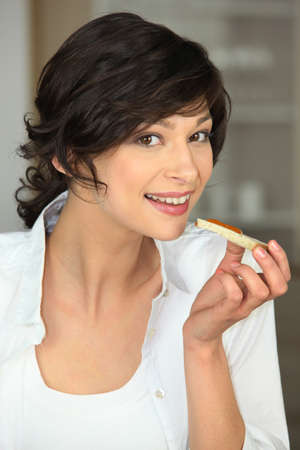 Woman eating a piece of bread Stock Photo - 14214559