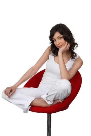 designer chair: Bored brunette sat in chair