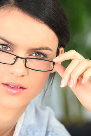 accommodate: Brunette with glasses