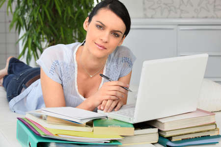 broadband: Woman doing homework, laid on a couch