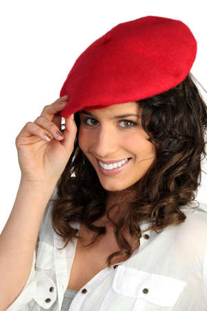 honest: young woman wearing a red beret