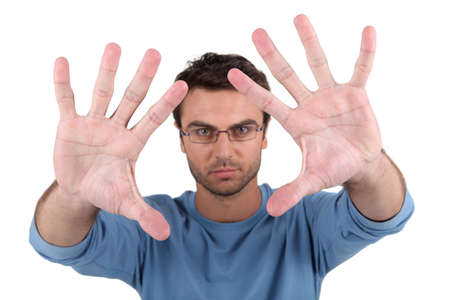 Extend: Man showing palms to camera Stock Photo
