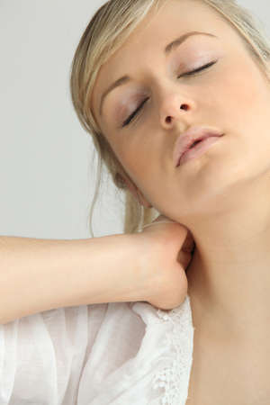 Blond girl with neck ache Stock Photo - 14214613