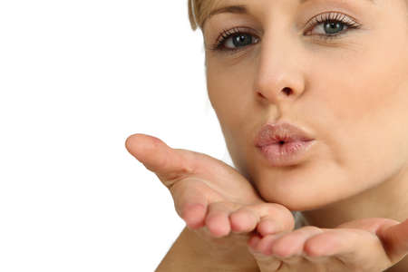 Woman blowing a kiss photo
