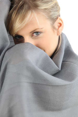 Woman wrapped up in a blanket photo