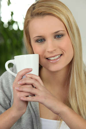 brew: Young woman with a hot drink