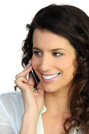 blabber: Woman talking on her mobile Stock Photo
