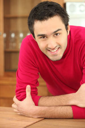amity: a smiling man in a kitchen
