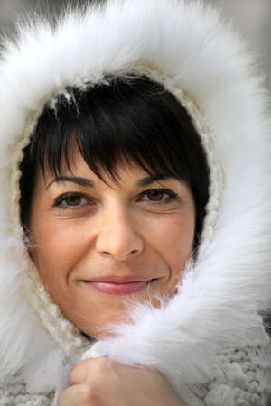 eskimo woman: Woman wearing fur hood