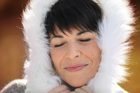 Woman wearing coat with fluffy hood Stock Photo - 14213426