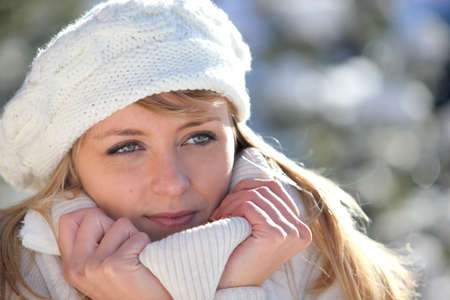 snuggling: Woman snuggling up to her warm clothing Stock Photo
