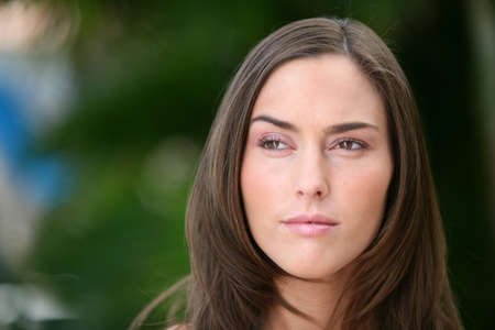 Portrait of serene brown-haired woman Stock Photo