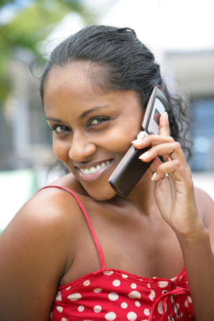 Black woman making a call on her mobile photo