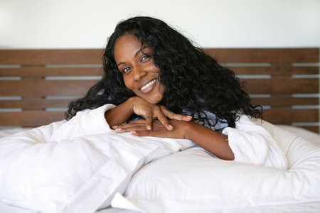 Smiling woman in bed Stock Photo - 14211088