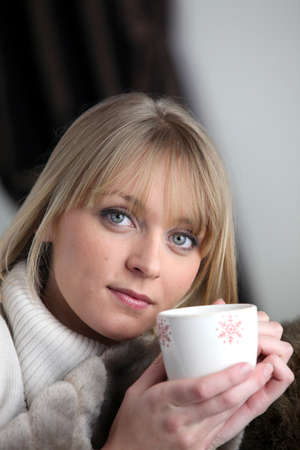 homey: Woman drinking a hot drink