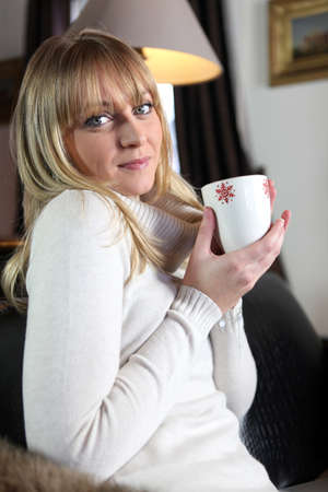 snugly: Woman having a hot cup of tea