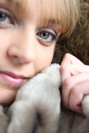 snugly: Woman snuggling up to a blanket