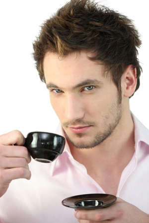 narcissist: Man having a cup of coffee
