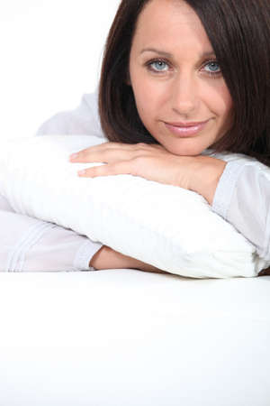 slumberous: Woman hugging her pillow