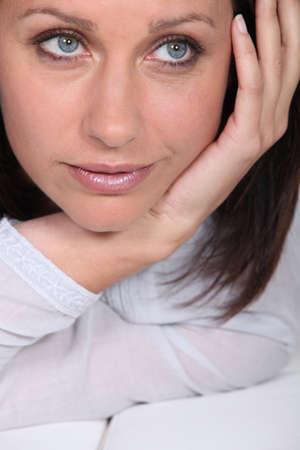 saddened: Womans face saddened Stock Photo