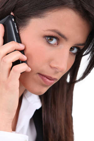 Portrait of brunette with mobile photo