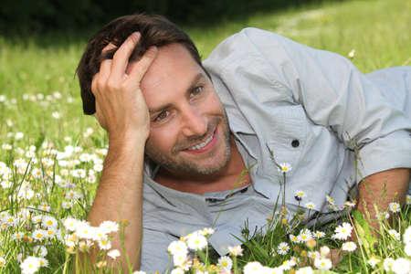 margaritas: Man lying on grass