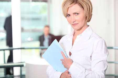 Office worker with files Stock Photo - 14211647