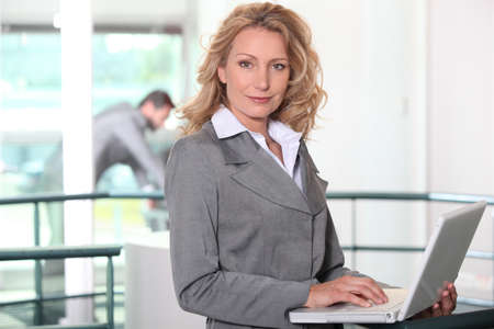 Executive blonde with computer photo
