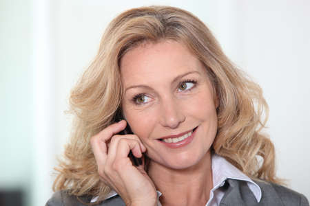 Portrait of blond mature woman having phone call Stock Photo - 14214084