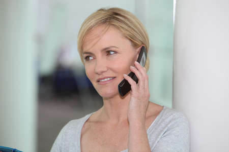 Woman using a cellphone Stock Photo - 14211106
