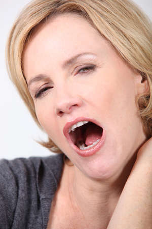 big mouth: Woman yawning Stock Photo