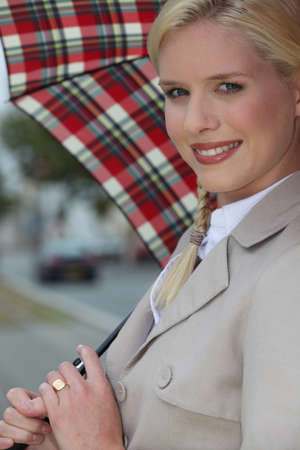 Scottish woman with umbrella photo