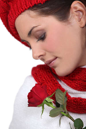 Brunette smelling rose photo