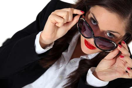 strict: Businesswoman posing in sunglasses