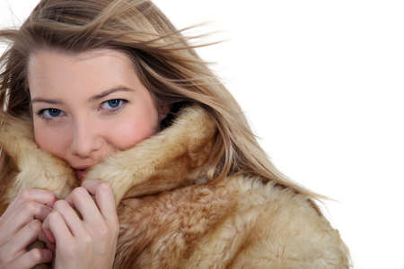 cruelty: Woman snuggling up to a fur coat
