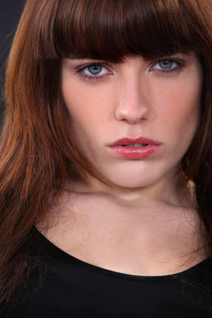 close-up portrait of attractive brunette looking worried photo