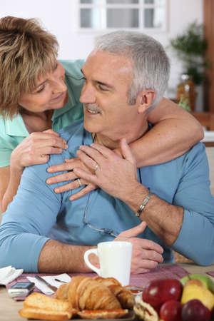 back up: Mature couple having breakfast Stock Photo