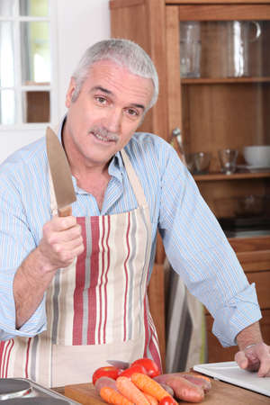 pileup: Man in the Kitchen Stock Photo