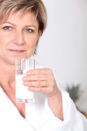 Woman with glass of milk photo