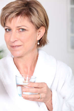 adequate: Woman with glass of water Stock Photo